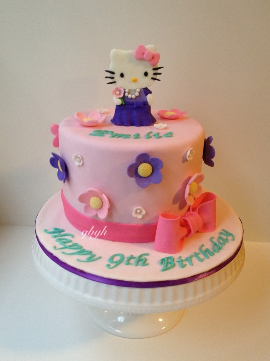 The Birthday Girl Requested For A Hello Kitty With Pink And Purple Flowers on Cake Central
