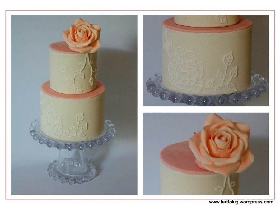 A Small Two Tiered Cake With A Piped Flower And Leaves Finished Off With A Pink Sugar Rose on Cake Central