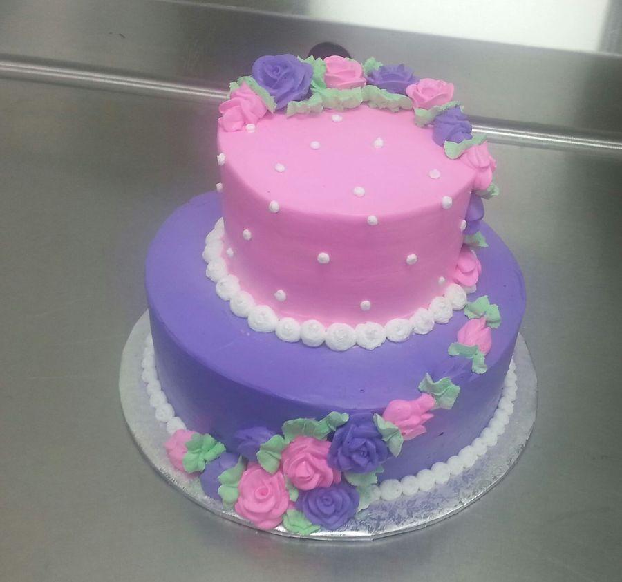 2 Tier White Cake With Whipped Icing In A Pink And Purple