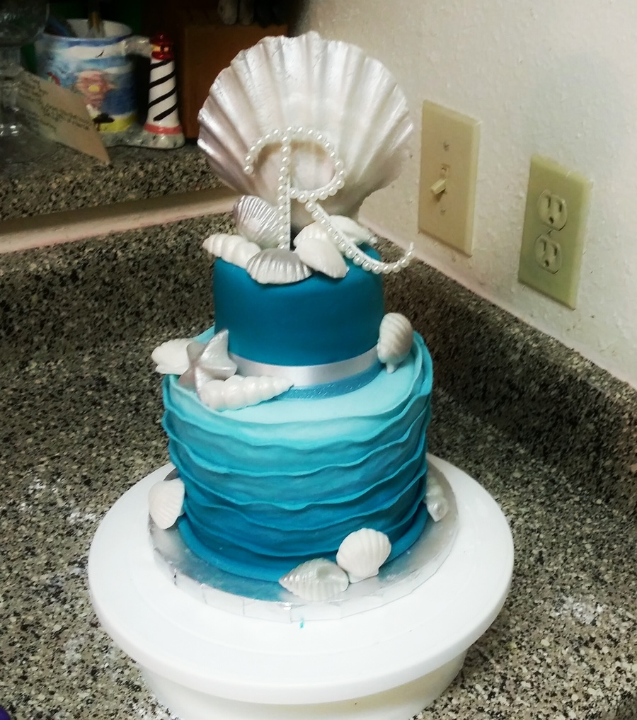 Sea Shell Wedding Cake With Fondant Shells And An Ombre Reverse Ruffle On Central