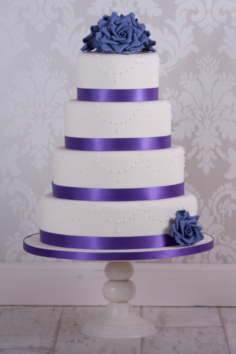 ivory wedding cake with purple roses purple wedding cake cakecentral 16552