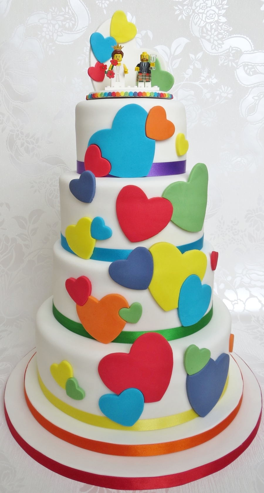 Rainbow Heart Wedding Cake With Lego Topper - CakeCentral.com