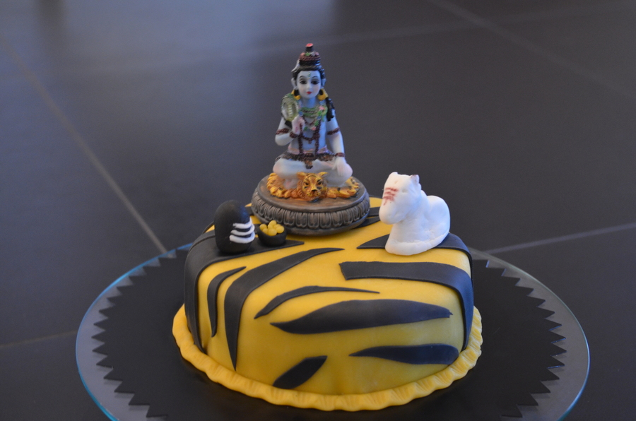 Mahashivratri The Night Of Shiva Lord Shiva Non Edible Fondant Shivling Fondant Ladoos And Fondant Sacred Cow On Tiger Stripes Cake  on Cake Central