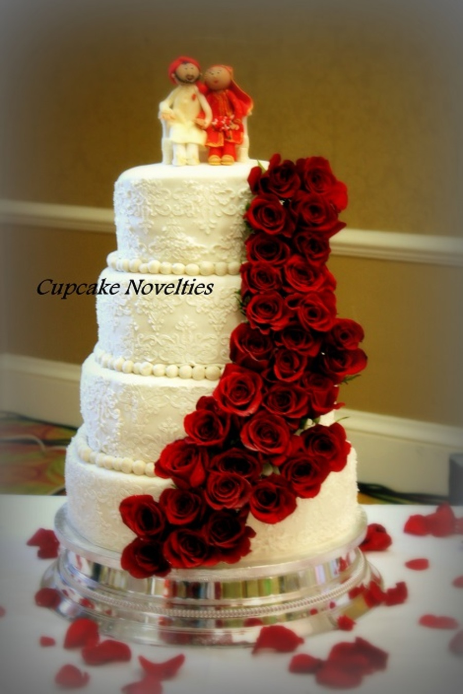 wedding cake with fresh red roses whiteivory lace wedding cake adorned with a cascade of 26895