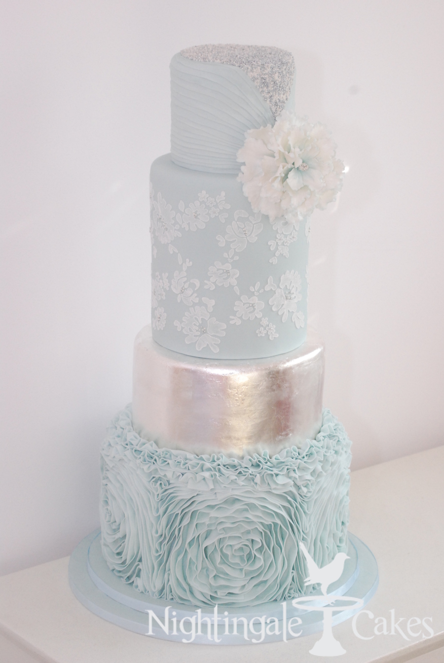 Pale Blue Wedding Cake With Silver Accents Lace Ruffles Silver Leaf ...