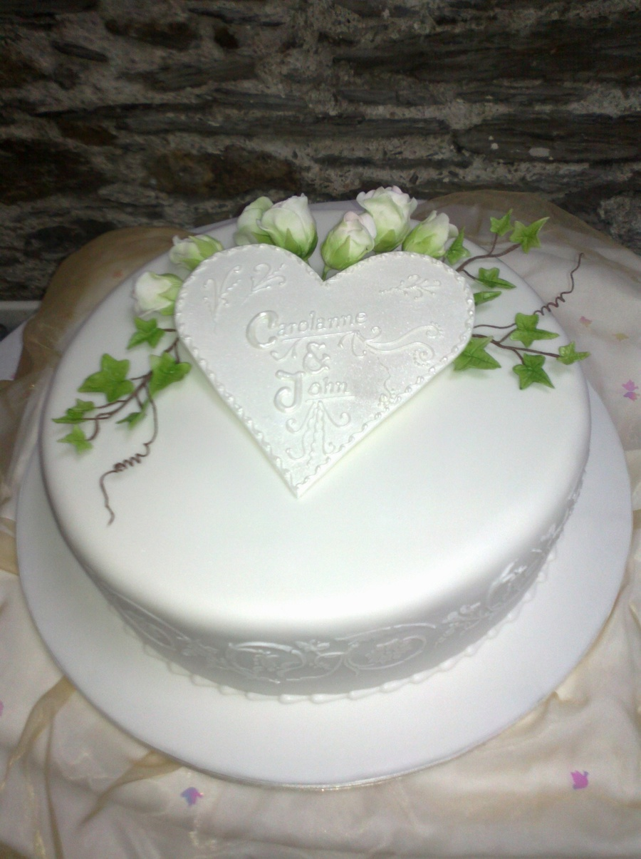 Fondant With Stencilling Pastillage Heart Surrounded By Gumpaste Flowers on Cake Central