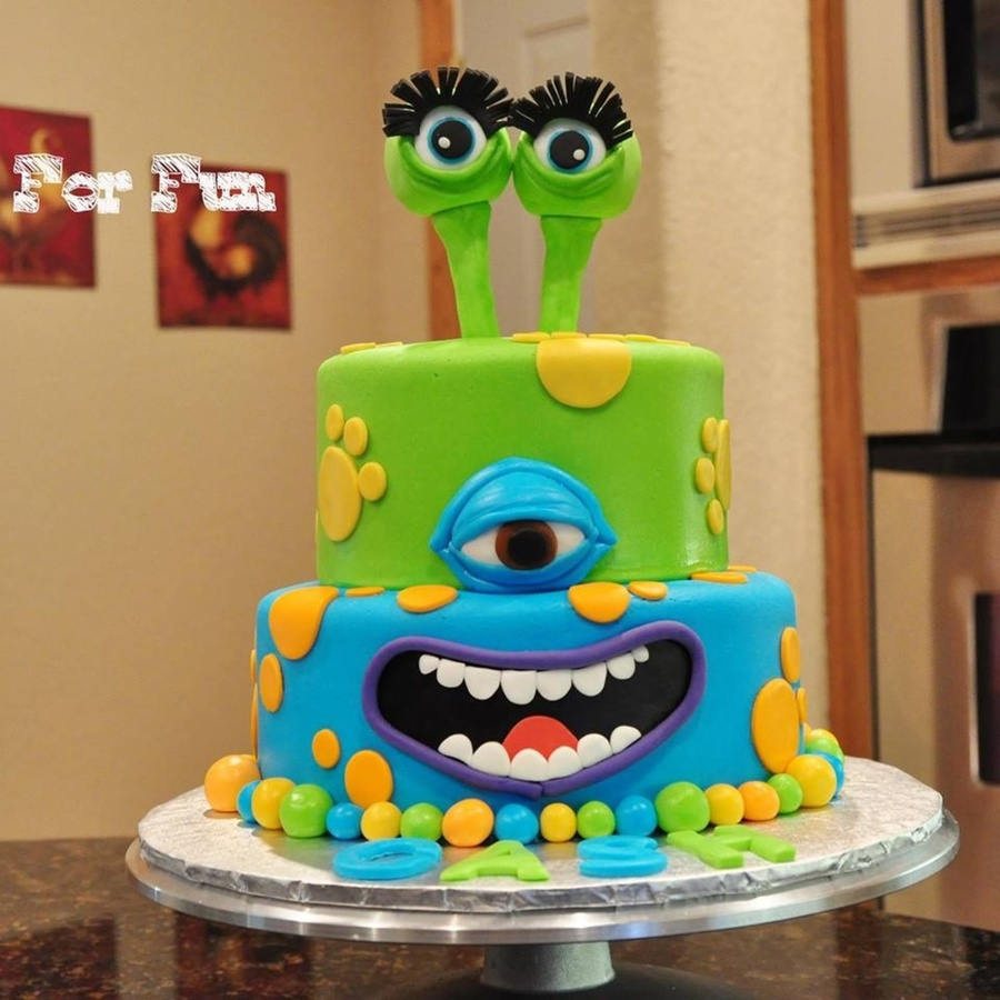 Brightly Colored Childs Monster Birthday Cake With Eyeball Topper