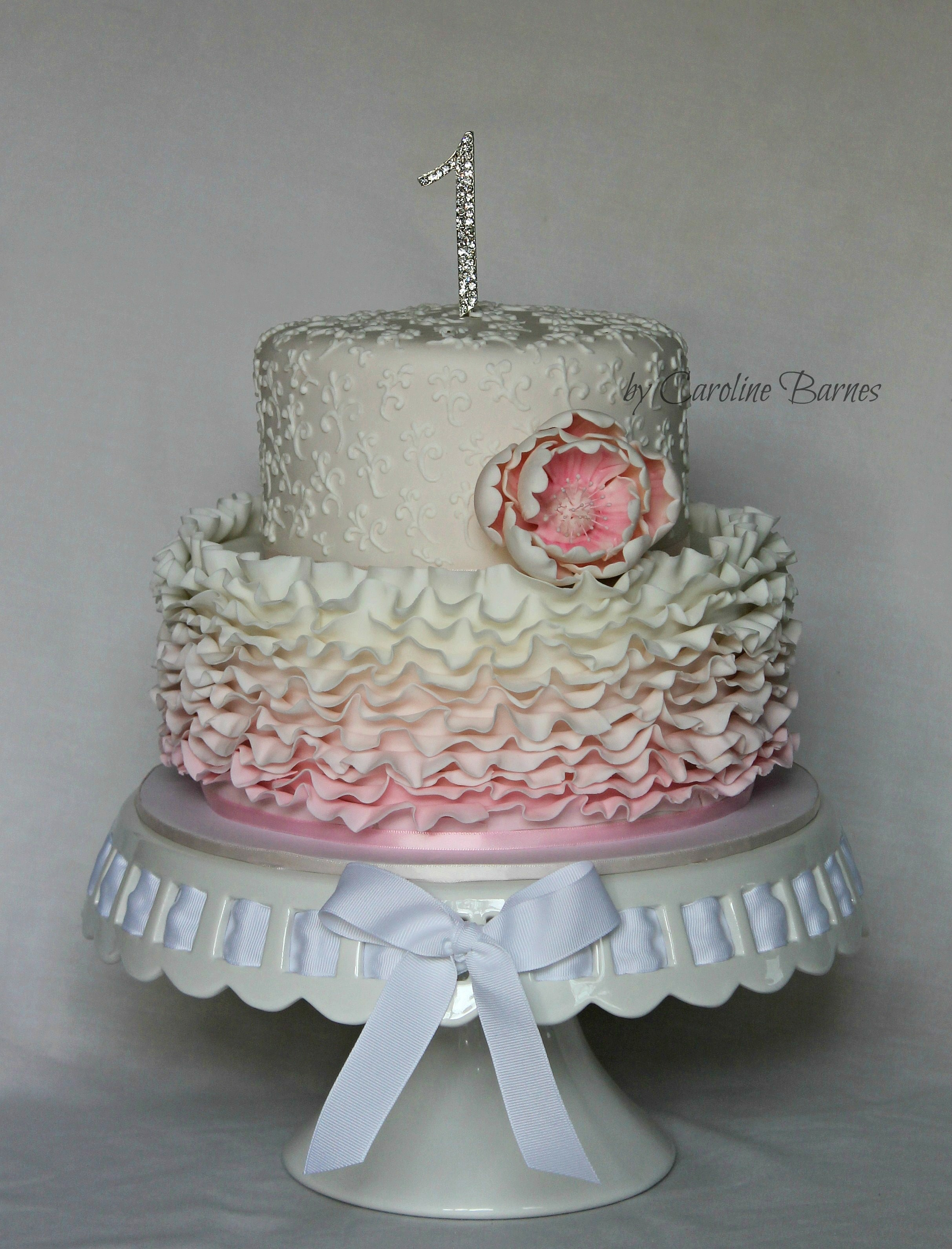 Pink First Birthday Cake With Ruffles Piping And Flower