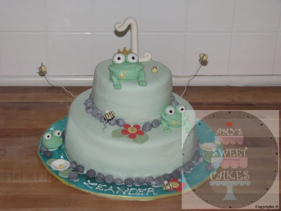Fondant Frogs And Blue Isomalt For The Base on Cake Central