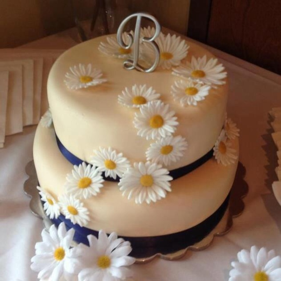 bridal shower theme was navy blue and white daisies 2 tiered fondant wrapped cakes with buttercream