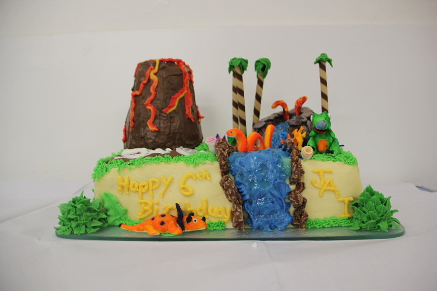 Dinosaur Birthday Cake Made With Red Velvet Cakeand Cream Cheese