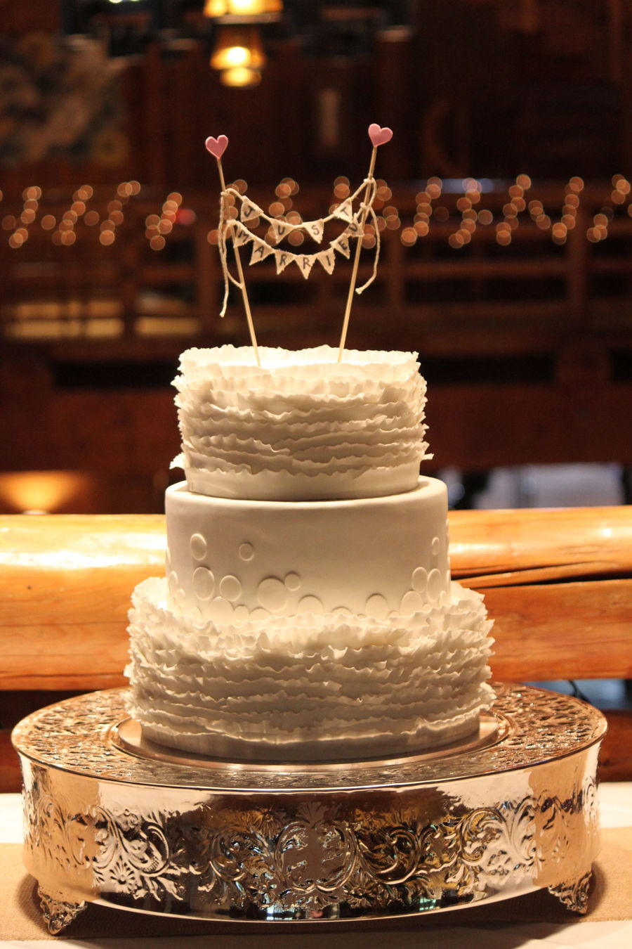 Romantic White Ruffled And Dotted Wedding Cake With Fabric Topper on Cake Central