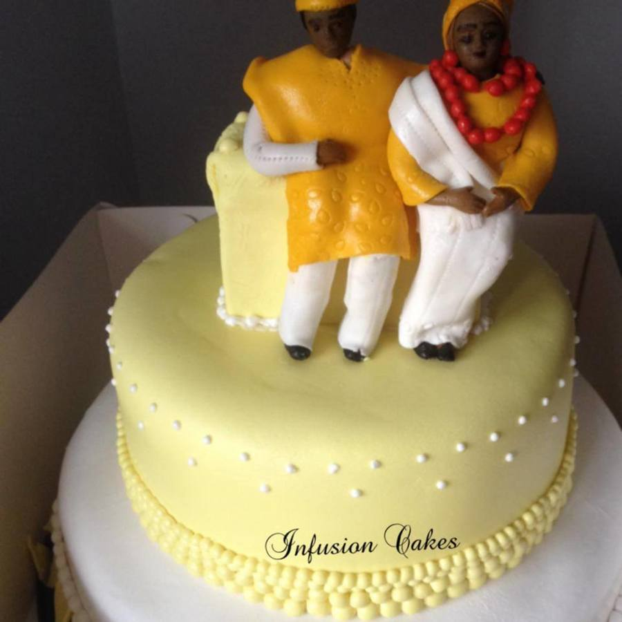 Nigerian Traditional Wedding Cake With Bride And Groom In The Native ...