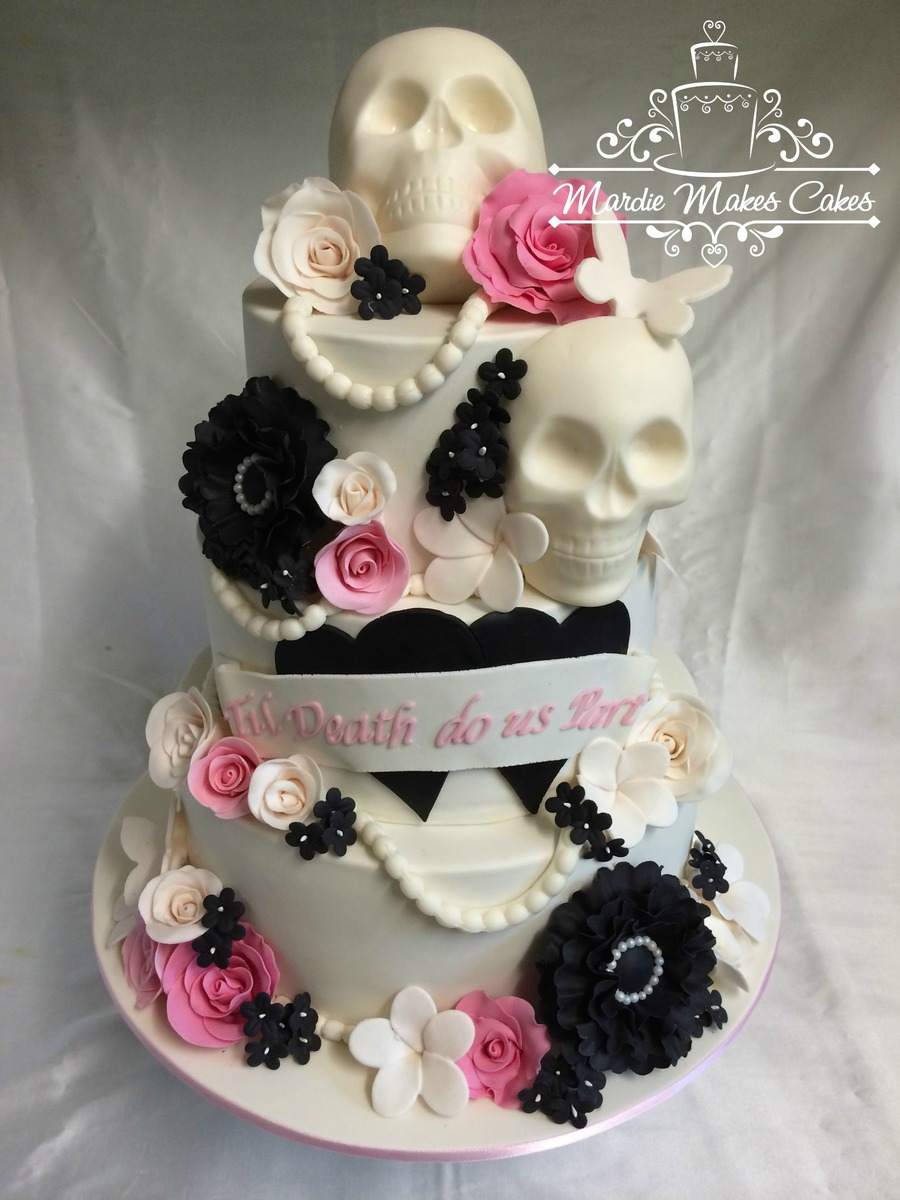 Skulls Wedding Cake a unique wedding cake for a unique couple. all chocolate cakes with smbc filling and mmf everything else. thanks for...