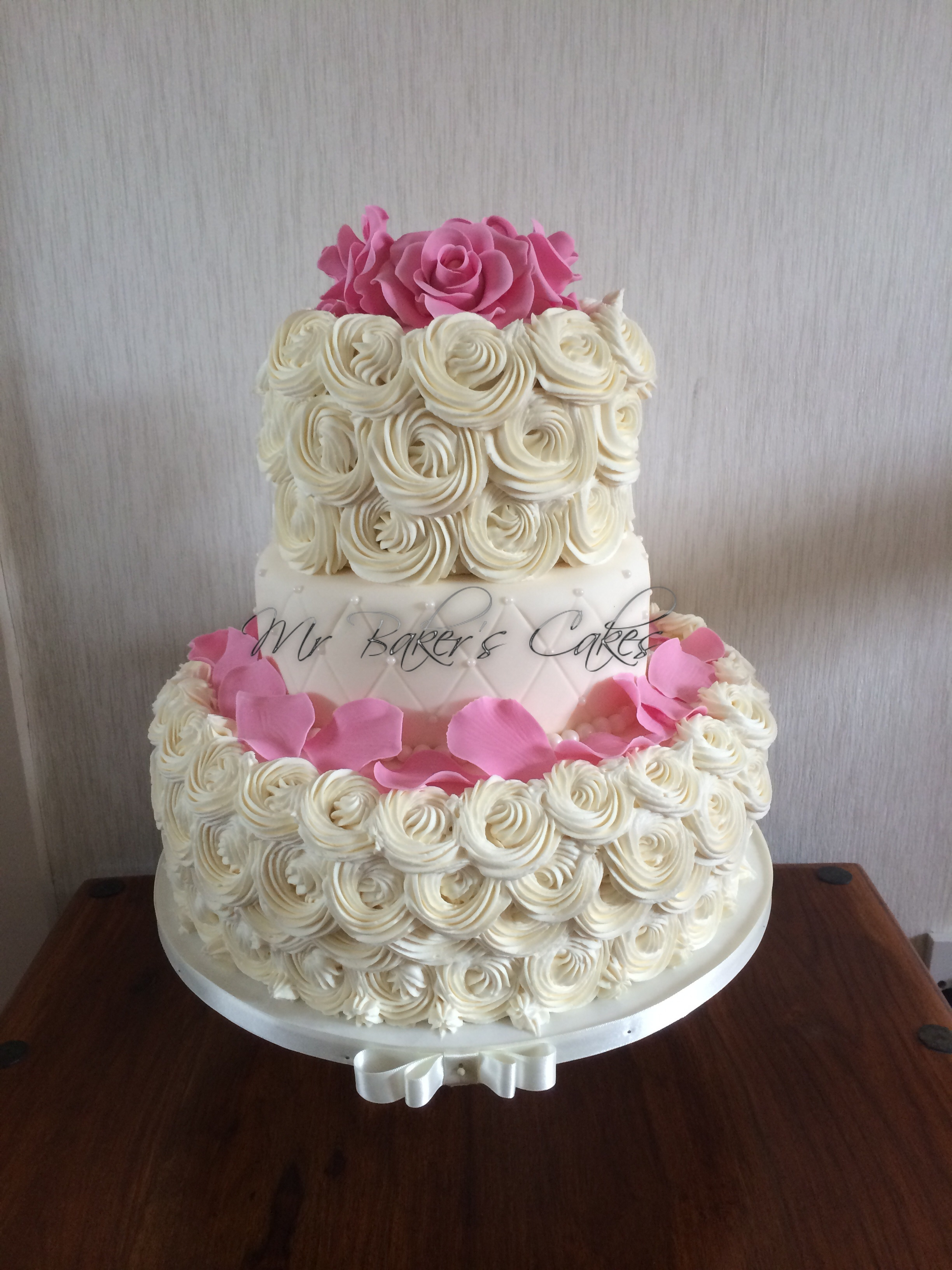 Vanilla Sponge Buttercream And Raspberry Jam Middle Tier Is Quilted Fondant With Edible Pearl Dragees Border