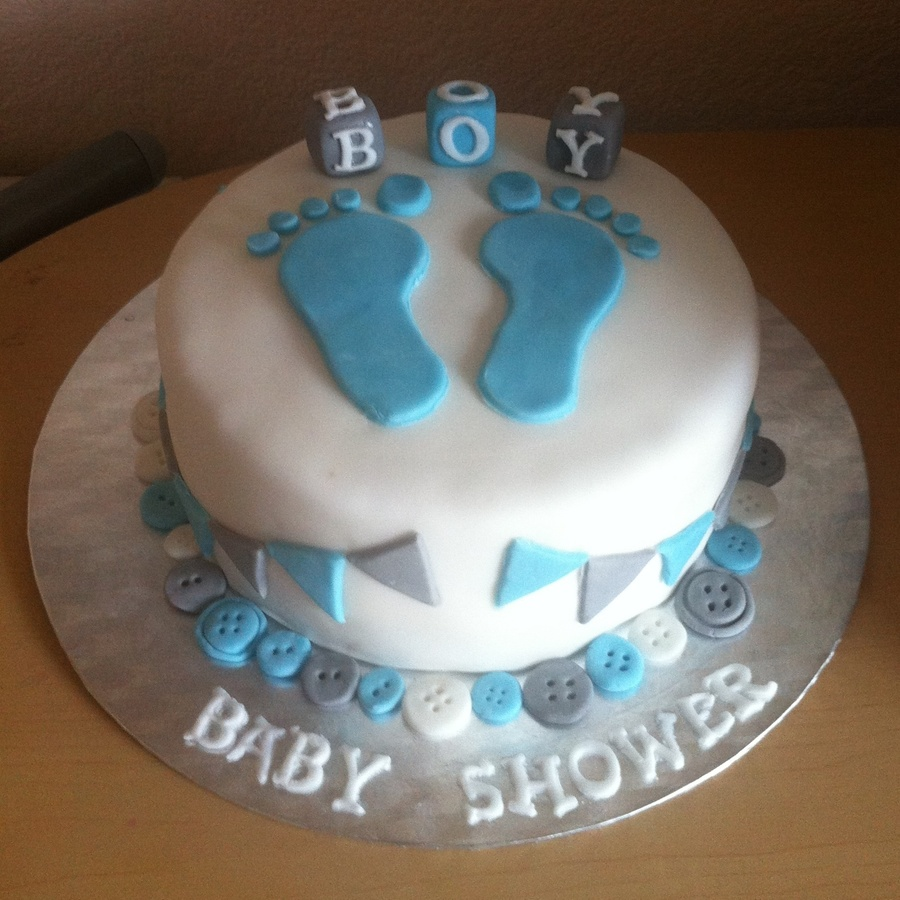 baby boy baby showe cake with fondant footprints blocks