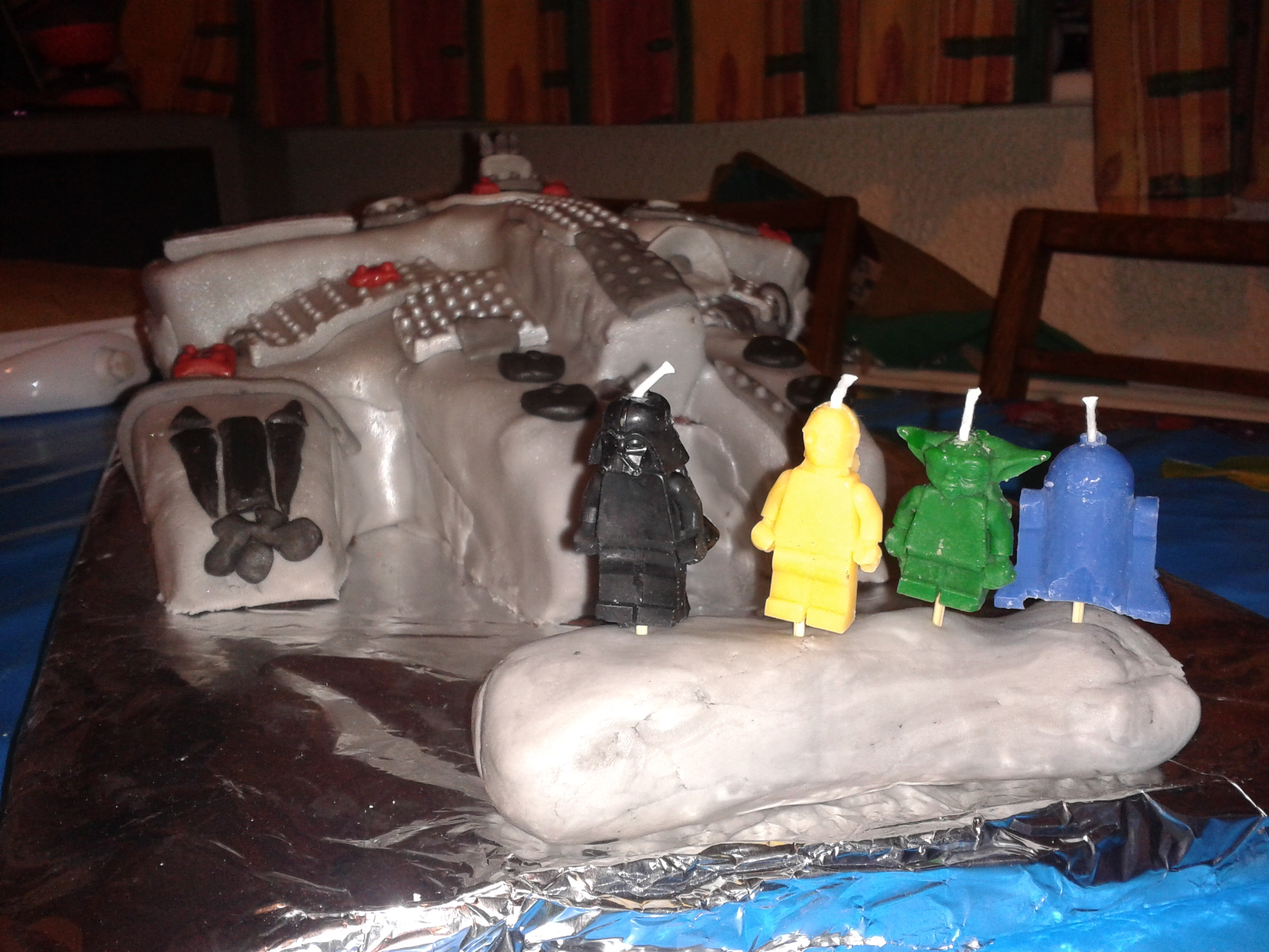 Lego Millenium Falcon Cake Make For An 8th Birthday Star Wars Figure Candles Add The Finishing Touches