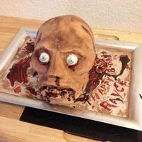 Zombie's Head Birthday Cake decorated in buttercream. The eyes are painted gumballs the only fondant used were buildups for the nose and bottom lip, for...
