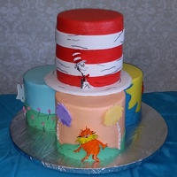 Seussian Inspired Cake 360 cake inspired by Lorax, Horton Hears a Who, Red Fish Blue Fish and Cat in the Hat. All buttercream with fondant and gumpaste...