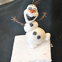 The Olaf I made this cute snowman with fondant and tylose powder.It was very fun making it...