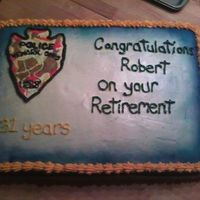 Retirement Cake Made this for my Dad's retirement party. The police shield is made out of royal icing.