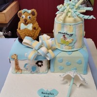 Baby Shower Cake For A Friend The cake is a marble cake covered in fondant with fondant bows and embellishments.
