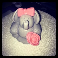 Baby Girl Elephant Cake topper for baby girl baby shower. Gum paste figure held together with gumpaste glue. Dyed grey and pink bow