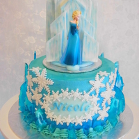 "'frozen' Buttercream Cake This was a 7"" cake iced in an ombre coloured buttercream. The ice castle topper and snowflakes were made out of fondant and the ice..."