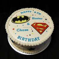 "Superhero Cake I made this for a set of twins who love superheros. Their favorites are displayed on the cake. It is a 10"" Chocolate cake, frosted and..."