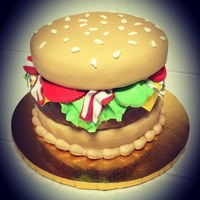 "Hamburger Cake 3 layer 8"" chocolate and confetti cake. Burger themed with fondant decorations."