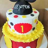 Leyton's Mickey Mouse Cake First birthday cake for Leyton. Unfortunately, our garage got too cold and the condensation as the cake came back to room temperature...