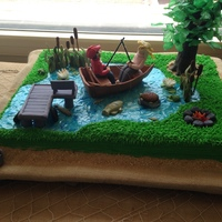 Fishing Cake This is the groom's cake I made for nephew's wedding. Many elements on the cake replicate items at the family's lake house,...
