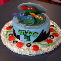 Teenage Mutant Turtles Birthday Cake  Made for a friend's little boy, who loves TMNT. I tried to make the heads following an tutorial, but gave up and used the cutters I...