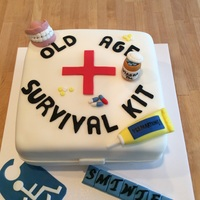 Old Age Survival Cake 8 in sq. cake covered in fondant