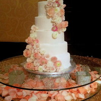 Sugared Buttercream This is a four tier sugared buttercream wedding cake with fresh flowers
