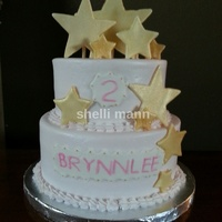 Star Cake This is a buttercream cake with fondant stars. The stars are coated with gold petal dust.