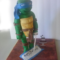 3D Ninja Turtle Cake Leonardo Ninja Turtle was 12 inches tall, Body & Head made with cake. All covered with a 50/50 modeling chocolate and fondant.