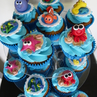 Underwater Sea Creatures Cupcakes  Vanilla cupcakes with vanilla bean buttercream featuring sweet little ocean critters. Crabs, starfish, whales, seahorses, fish and...