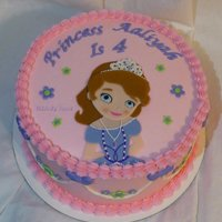 "Sofia The 1St Birthday Cake   This is an 8"" alternating chocolate & yellow cake, frosted in buttercream. All decorations are hand made from fondant."