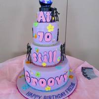 Disco Cake Birthday cake made for a lady turning 70. WASC cake with raspberry cream cheese filling. The disco ball on top was battery operated and...