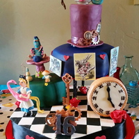 Alice In Wonderland-Steampunk Birthday Cake  It was for a 16th Birthday. She wanted Vintage Alice in Wonderland with some Steampunk flair to it. I did my best in incorporate them. The...