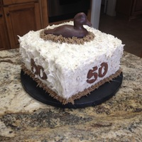 Tim's 50Th Italian Cream cake iced with cream cheese icing topped with pecans. Chocolate duck on top