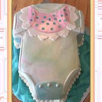 Tye-Dyed Baby Onesie This sweet baby onesie is white cake filled with a thin layer of raspberry coulis and lemon mousse. Blanket is fondant. Thanks for looking...