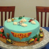 Planes Fire Rescue 9inc carrot cake with cream cheese filling and MMF. The characters are toys. Other decorations on the cake re fondant