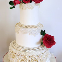 Ruffles And Roses... Pearls And Lace Ruffles and Roses... Pearls and laceThis is a very elegant cake with lots of hand made lace and pearls and ruffles. Time consuming but...
