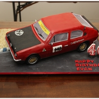 Alfa Romeo Racing Car Cake Alfa Sud racing car cake for a friend's birthday. The car was on a metal frame base and had two wheels off the ground. He loved the...