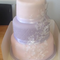 Three Tier Stacked Cake. This is my first attempt at making a stacked cake. Pink/lilac tiers with white wafer butterflies for decoration.