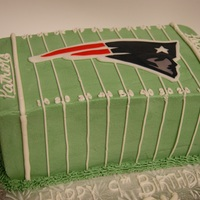 New England Patriots Cake Small cake for my son's birthday. Made with a square cake pan, cut and stacked. Buttercream finish. Patriot logo is fondant.