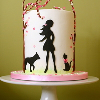Spring Girl this cake was for a girl who adores her dog and cat and loves almond and cherry trees. It is a double barrel cake and I really loved it......