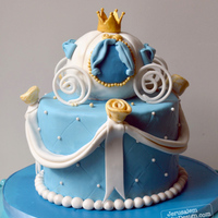 Cinderella Cake Vanilla cake covered in fondant. Coach is made from rice krispies treats covered in fondant.